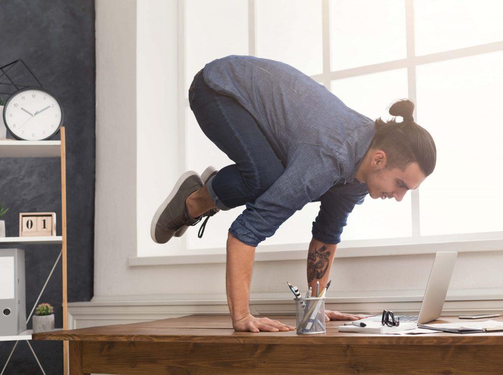 Man Balancing on Table